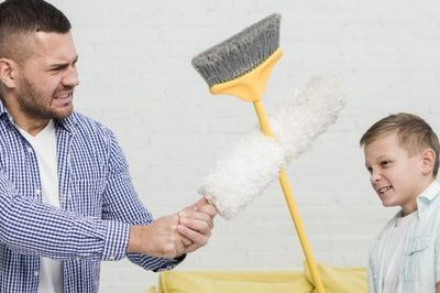 father-son-play-fight-with-broom-duster